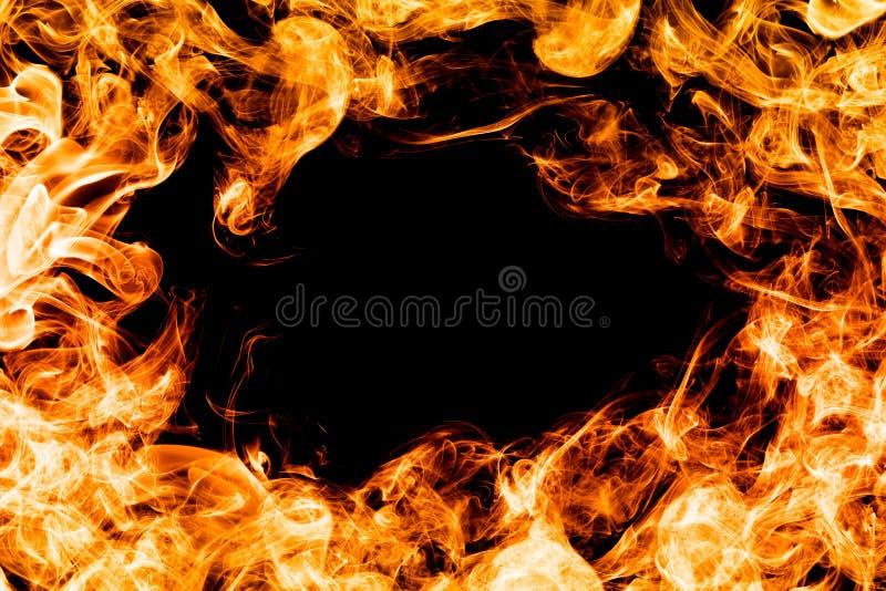 Увольняйте пламена на черной предпосылке, рамке, границе стоковое изображение