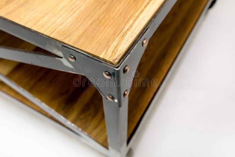 Угол Ironwork с заклепками Отладка для таблицы стоковое фото rf