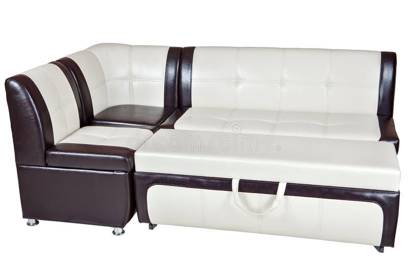 Угловая диван-кровать в коже faux, изолированной мебели столовой, стоковое изображение rf