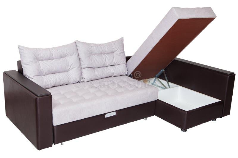 Угловая обратимая диван-кровать с системой хранения, whit драпирования стоковое фото