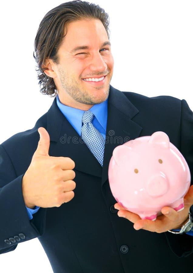 удерживание бизнесмена банка счастливое piggy стоковые фотографии rf