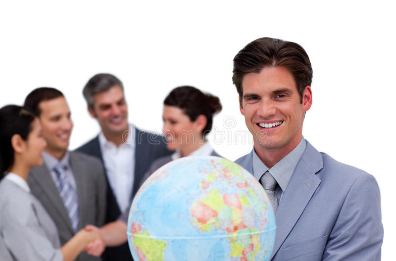 удерживание глобуса бизнесмена счастливое стоковое фото rf