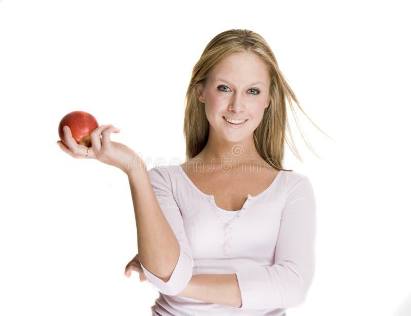 удерживание девушки яблока стоковые изображения