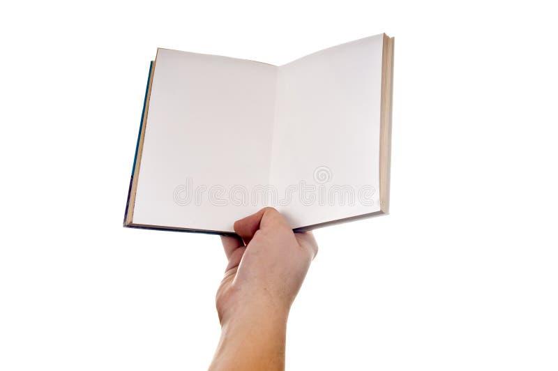 удерживание книги стоковое изображение rf