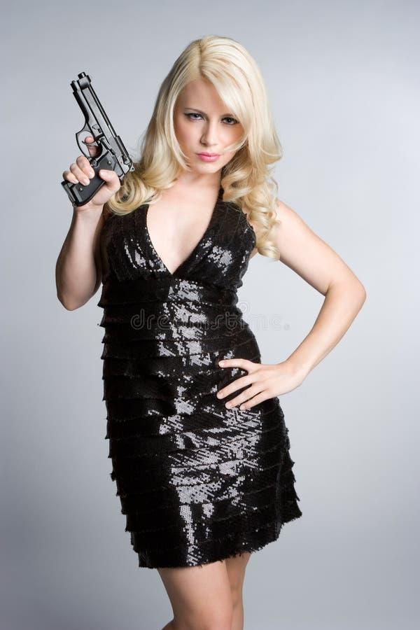 удерживание пушки девушки стоковые изображения