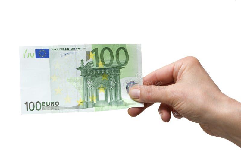удерживание руки евро 100 стоковые фото