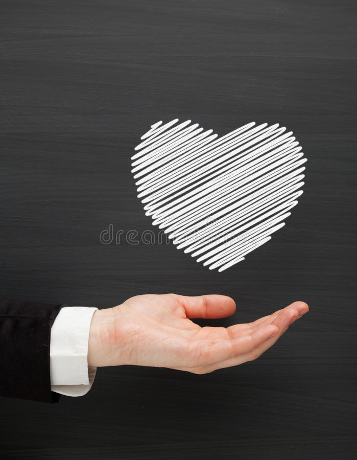 Download удерживание сердца руки стоковое изображение. изображение насчитывающей схематическо - 18379469