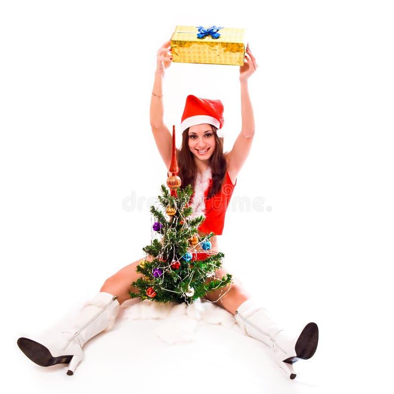 удерживание santa хелпера девушки подарка коробки стоковая фотография