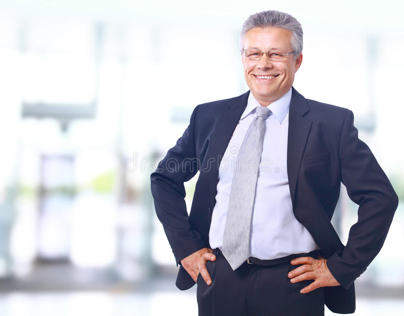удовлетворенное бизнесмена возмужалое стоковые фотографии rf