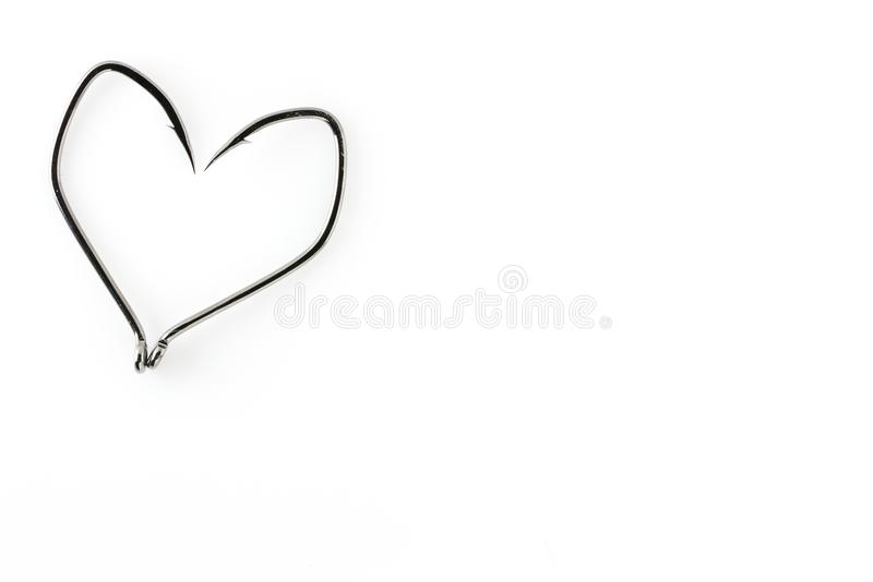 Удя крюки в форме сердца на белой предпосылке стоковое фото rf