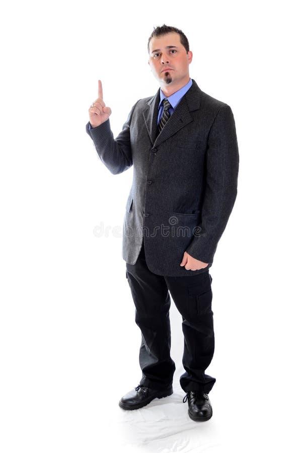 указывать вверх Человек в костюме стоковые фотографии rf