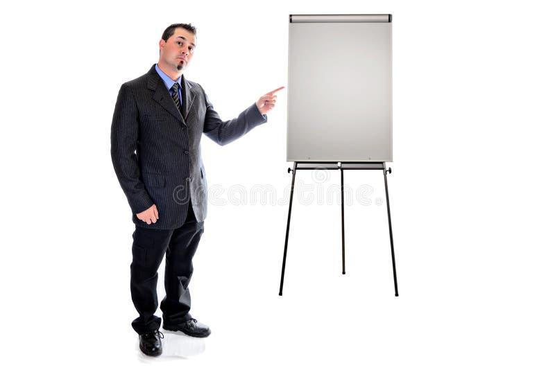 Указывать к мольберту представления Человек в костюме стоковое изображение