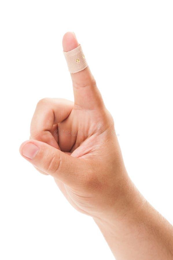 Указывающ залатанный палец стоковые фото