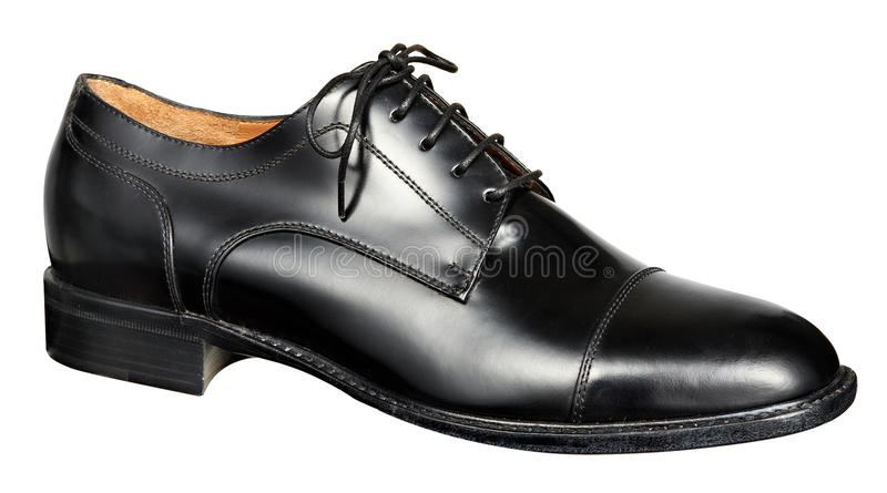 Укомплектовывает личным составом черный кожаный ботинок стоковые фото