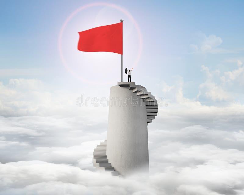 Укомплектуйте личным составом веселить на верхней части башни с лестницами и волнистым флагом стоковые изображения