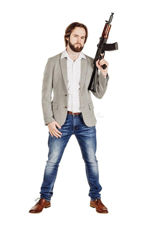 Укомплектуйте личным составом держать пулемет изолированный на белой предпосылке стоковое изображение rf