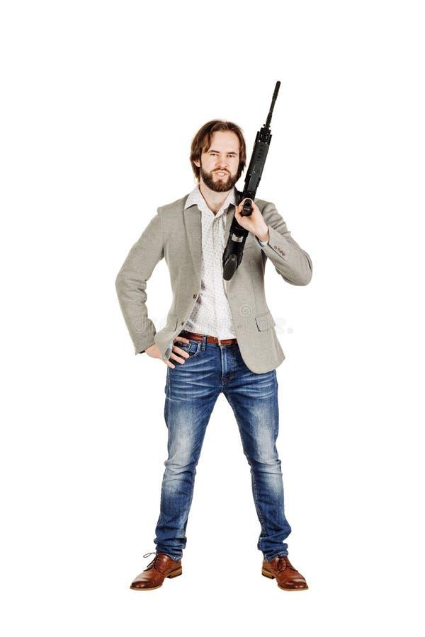 Укомплектуйте личным составом держать пулемет изолированный на белой предпосылке стоковое изображение