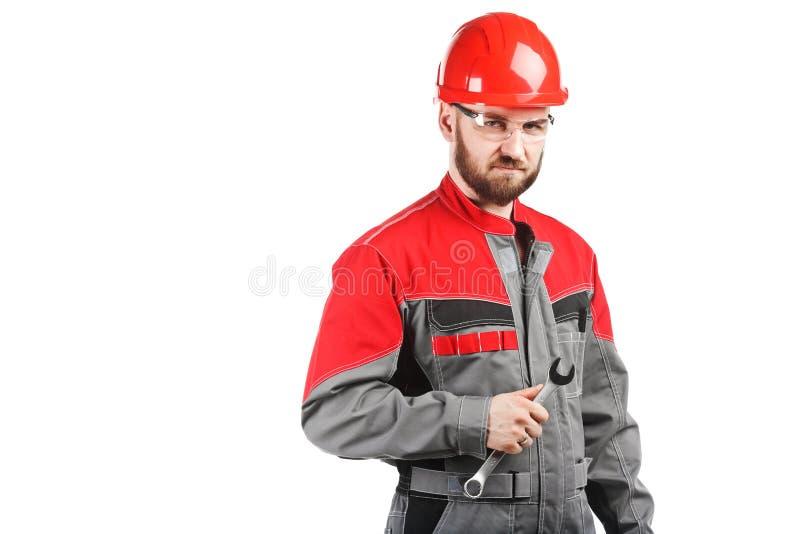 Укомплектуйте личным составом нося прозодежды с красным шлемом и взламывайте стоковые изображения rf