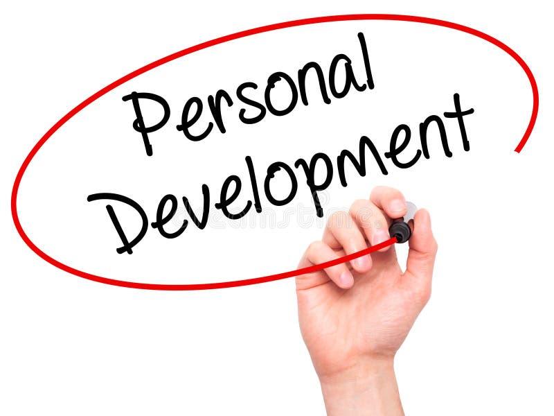 Укомплектуйте личным составом руку писать личное развитие с черной отметкой на visu стоковая фотография