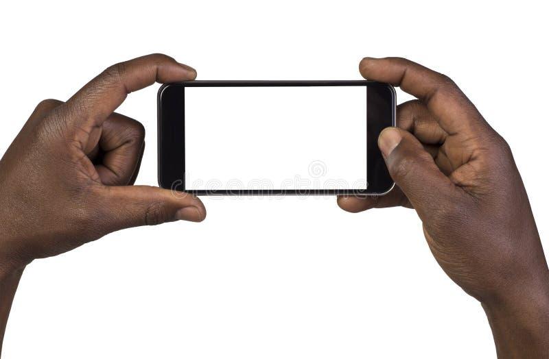 Укомплектуйте личным составом фотографировать используя умный телефон стоковая фотография