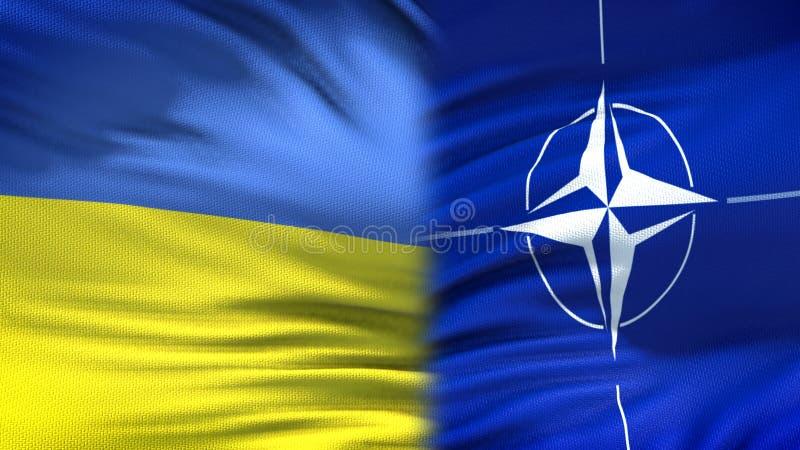 Украина и предпосылка флагов НАТО, дипломатический и экономические отношения, военные стоковая фотография
