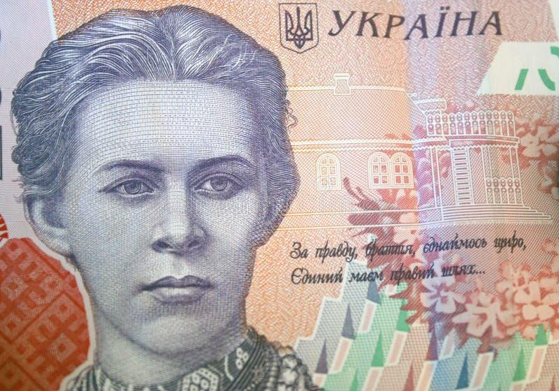 Украинские деньги Банкнота украинского hryvnia Предпосылка 200 банкнот hryvnia, монеток в кучах, конце-вверх стоковые изображения