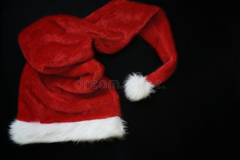 Украшение рождества с местом для приветствовать на классн классном мела Шляпа и подарочные коробки Санта Клауса стоковое фото
