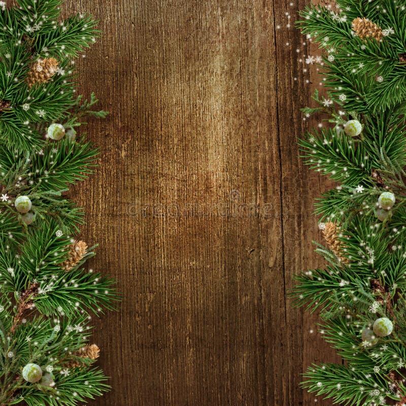 Украшение рождества с границей ветви ели на backg древесины grunge стоковое фото