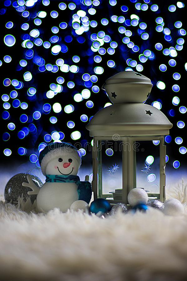 Украшения рождества с подсвечником и снеговиком стоковое фото