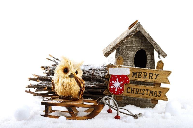 Украшения рождества: сыч, birdhouse и шильдик стоковые фото