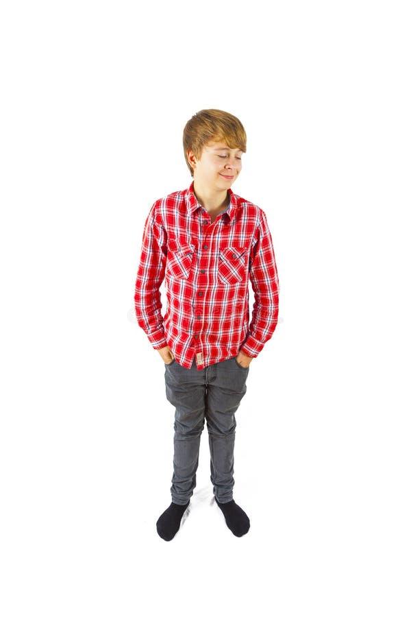 Умный мальчик стоит в студии стоковая фотография rf
