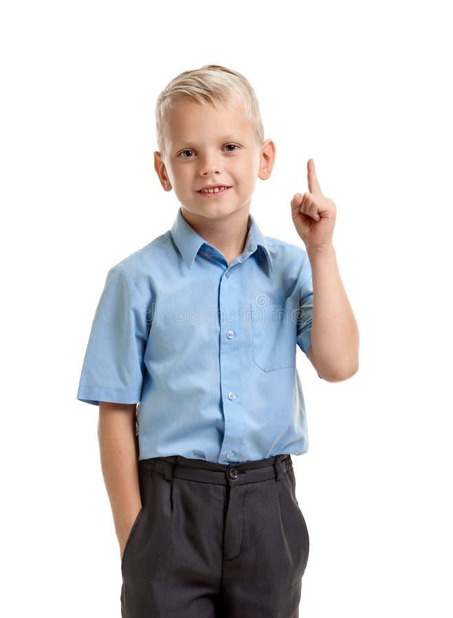 Умный усмехаясь мальчик с идеей стоковое изображение rf