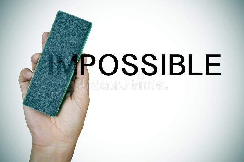 Уничтожающ слово невозможное с ластиком стоковое фото