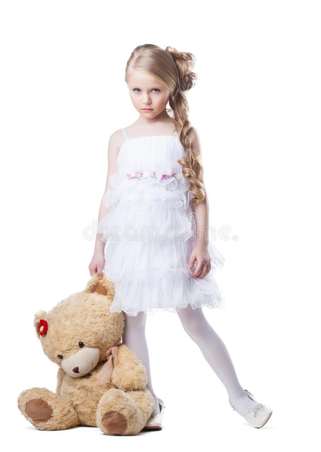 Унылая маленькая девочка с мягкой игрушкой стоковое изображение