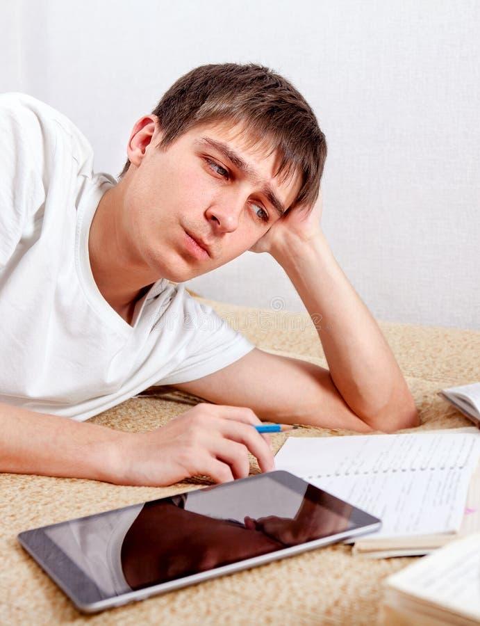 Унылый и утомленный студент стоковая фотография