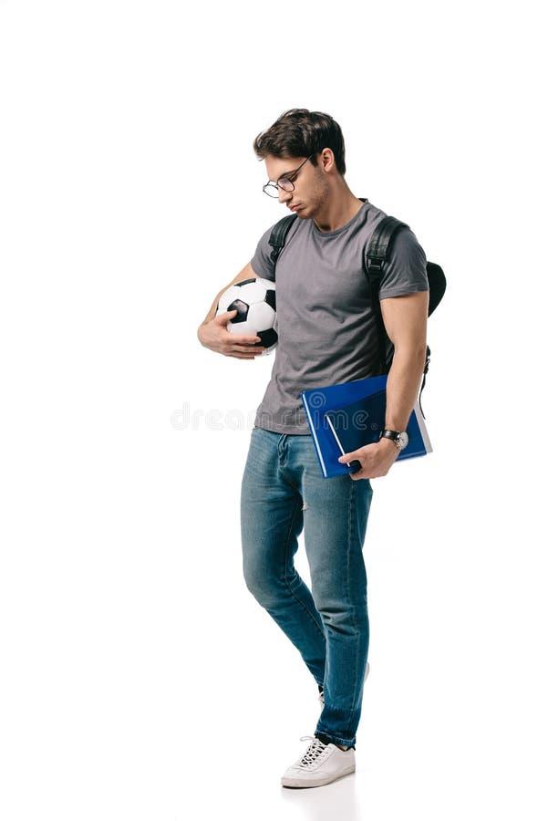 унылый красивый студент держа шарик футбола стоковая фотография rf