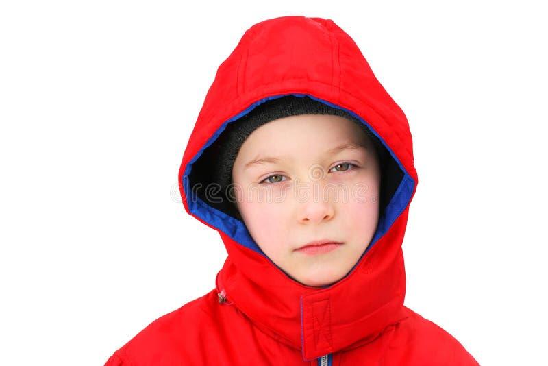 Унылый мальчик в зиме стоковые изображения
