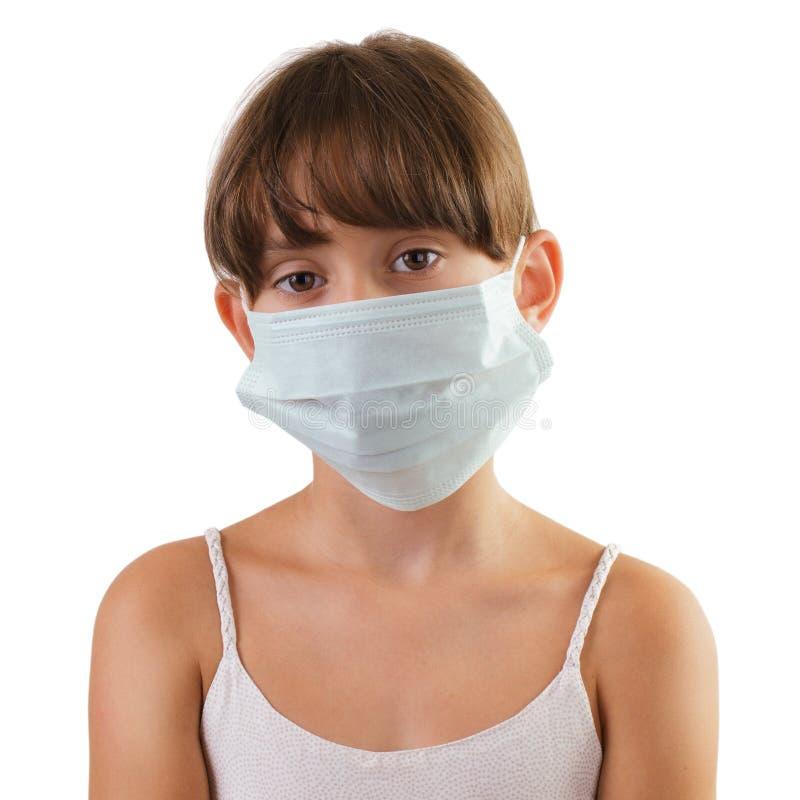 Унылая девушка в медицинской маске стоковые фото