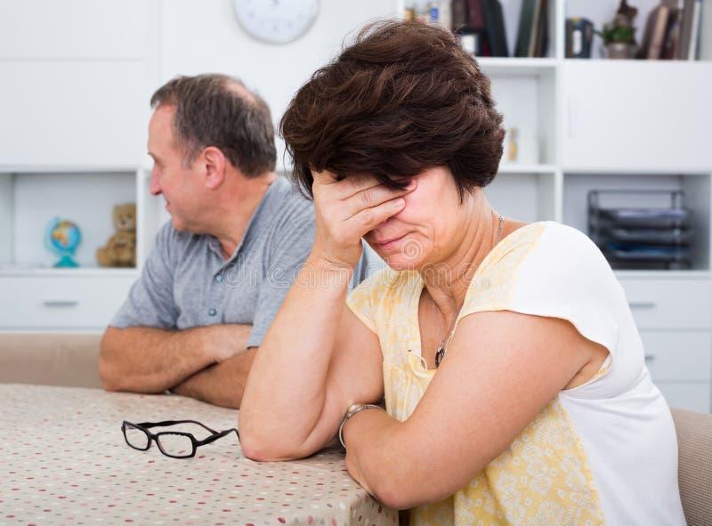 Унылая женщина испытывая проблемы семьи стоковое фото rf