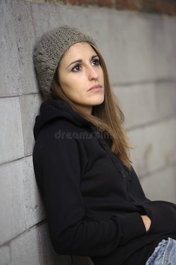 Унылая молодая женщина с связанной шляпой стоковое фото rf