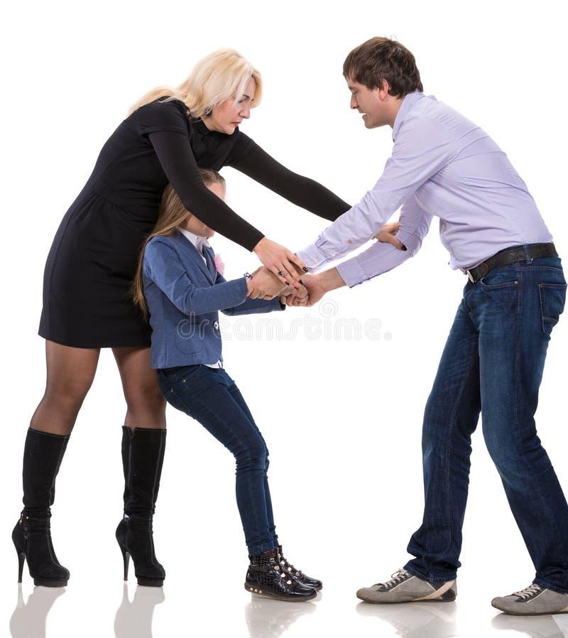 Унылая смотря девушка с ее воюя родителями стоковые фотографии rf