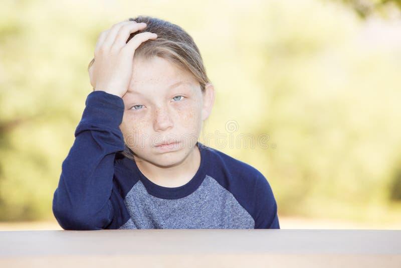 Унылый или больной мальчик стоковое фото rf