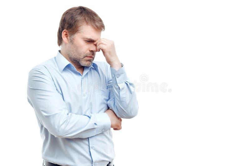 Унылый человек касаясь его носу стоковые изображения rf
