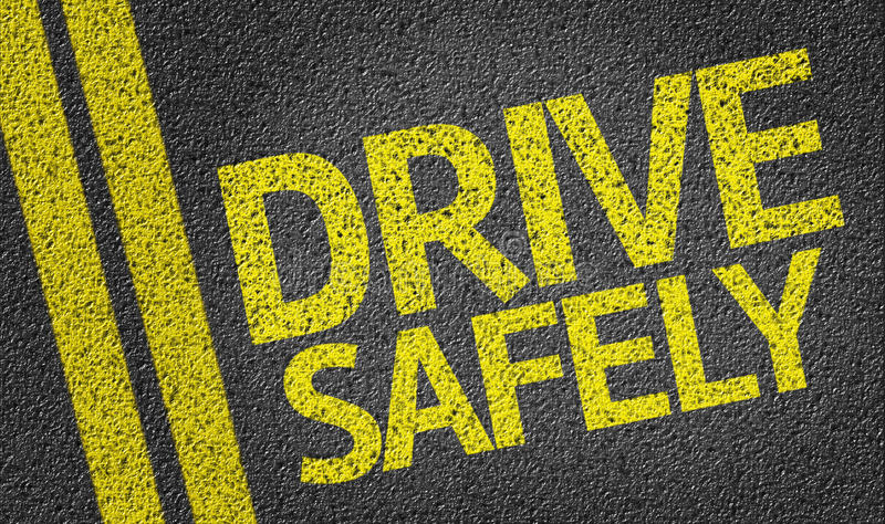 Управляйте безопасно написанный на дороге стоковые фотографии rf