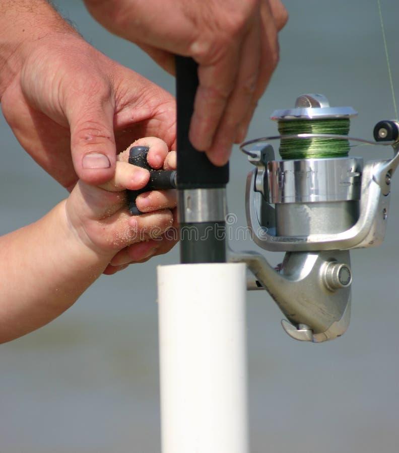 урок рыболовства стоковые изображения
