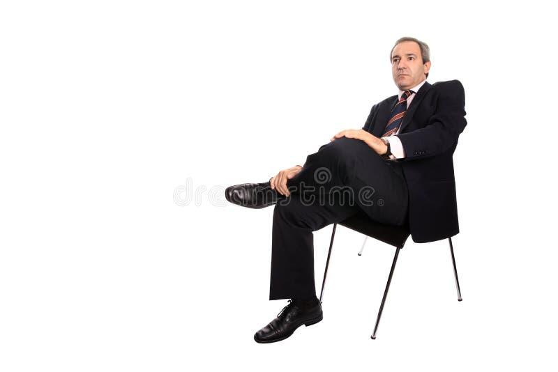 усаженный стул бизнесмена стоковые фотографии rf