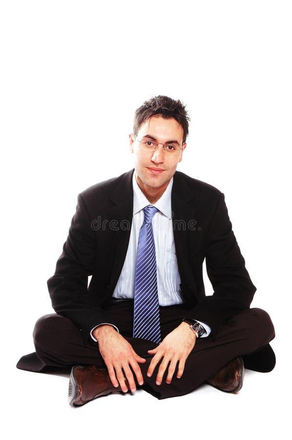 усаживание бизнесмена стоковое изображение