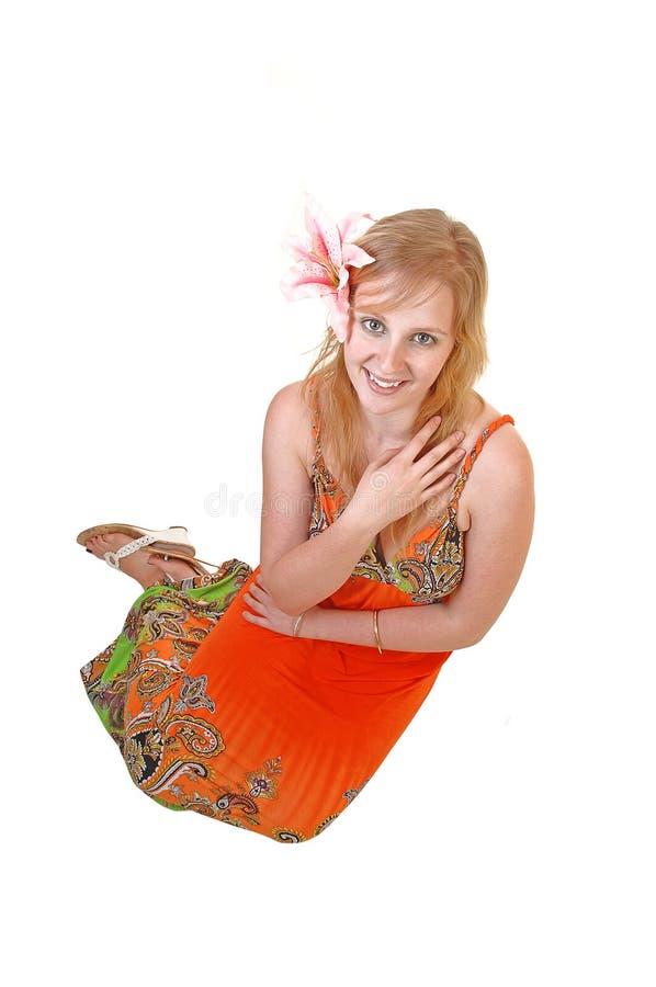 усаживание девушки пола симпатичное предназначенное для подростков стоковое изображение