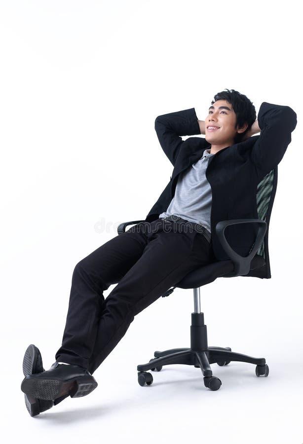 усаживание стула дела ослабленное человеком стоковая фотография