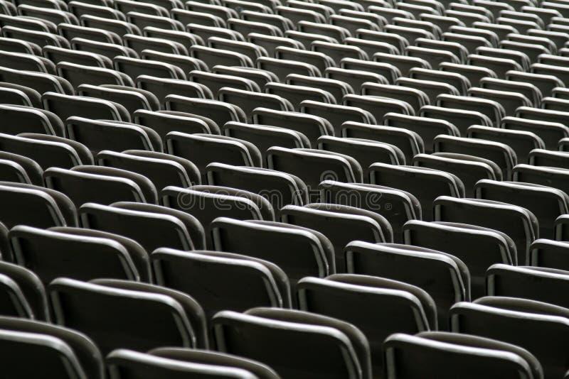 Усаживать в футбольный стадион стоковые фото
